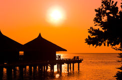 Water bungalows and sunset Stock Photo