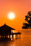 Water bungalows and sunset Stock Photography