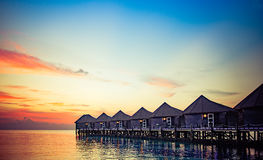 Water bungalows at sunset Stock Photography