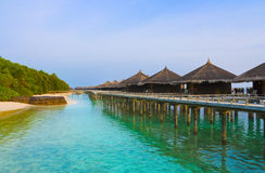 Water bungalows on a tropical island at evening Royalty Free Stock Photography