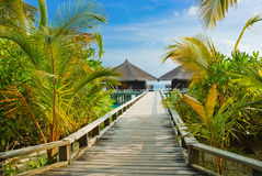Water bungalows on a tropical island at evening Stock Photography