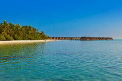 Water bungalows on tropical Maldives island Royalty Free Stock Photos