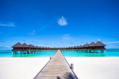 Water bungalows and wooden jetty on Maldives Stock Images