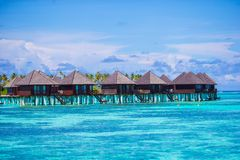 Water bungalows and wooden jetty on Maldives Royalty Free Stock Photos