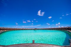 Water bungalows and wooden jetty on Maldives Royalty Free Stock Photo