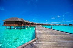 Water bungalows and wooden jetty on Maldives Stock Photography