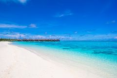 Water bungalows and wooden jetty on Maldives Royalty Free Stock Images