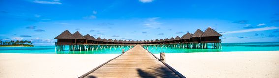 Water bungalows and wooden jetty on Maldives Royalty Free Stock Image
