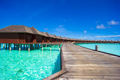 Water bungalows and wooden jetty on tropical Stock Photo