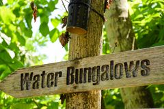 Water bungalows wooden sign at the tropical island. At Maldives Royalty Free Stock Images