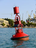 Water buoy. Red water buoy with warning light royalty free stock photo