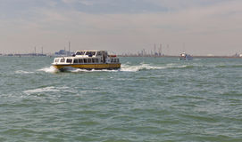 Water bus sails in Venice lagoon, Italy. Stock Images