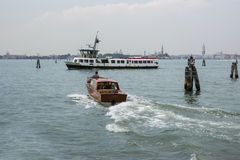 Water bus and taxi in summer Venice Stock Photo