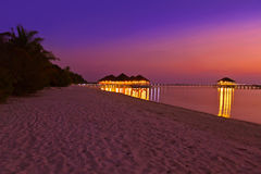 Water cafe at sunset - Maldives Royalty Free Stock Image