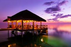Water cafe at sunset - Maldives Stock Photos
