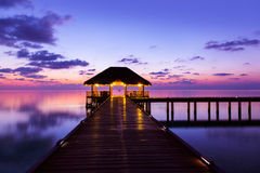 Water cafe at sunset - Maldives. Vacation background Stock Photo
