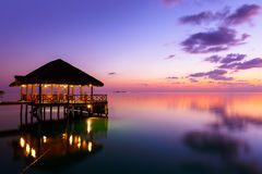 Water cafe at sunset - Maldives Royalty Free Stock Photo