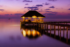 Water cafe at sunset - Maldives Stock Photography