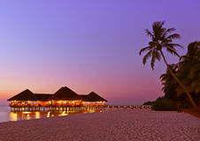 Water cafe at sunset - Maldives Royalty Free Stock Images