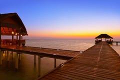Water cafe at sunset - Maldives Royalty Free Stock Image