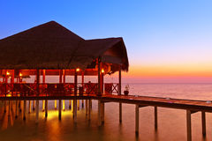 Water cafe at sunset - Maldives Stock Images