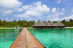 Water cafe on a tropical beach at Maldives Royalty Free Stock Images