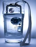 Water and camera. Water bubbles and digital camera Stock Photos