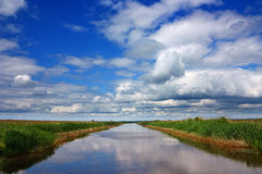 Water canal, blue sky Stock Photo
