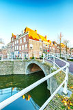 Water canal bridge and houses Stock Photo