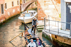 Water canal with gondola in Venice Royalty Free Stock Image