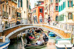Water canal with gondolas in Venice Stock Images