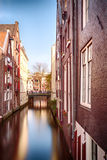 Water canal and houses in Amsterdam Stock Images
