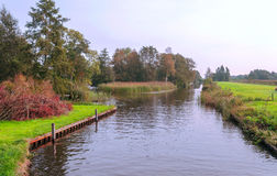 Water canal in the meadows Royalty Free Stock Photos