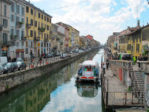 Water canal in Milano with boat and cafe 436, Italia, 2012 Stock Photo
