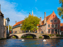 Water canal with old bridge and medieval houses of Stock Photography