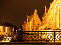 Water canal at Old Saint John`s Hospital by night, Bruges, Belgium.  Stock Photos