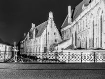 Water canal at Old Saint John`s Hospital by night, Bruges, Belgium. Black and white image Stock Photos