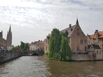 Water canal ramification in Bruges with old buildings Stock Photography