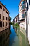 Water canal with reflections in Padova Royalty Free Stock Photo
