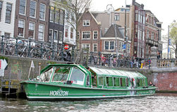 Water canal and typical architecture in Amsterdam, Netherlands royalty free stock image