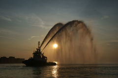 Water cannon salute. Boat in action in Trieste. Royalty Free Stock Photography