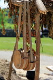 Water canteens. Two water canteens of soldiers hanging from rough-hewn wood structure at war reenactment Stock Photos