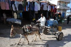 Water carrier on the street Hargeisa Stock Image