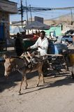 Water carrier on the street Hargeisa. Royalty Free Stock Photos