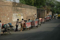 Water cart workers on their way to work. Delhi, India Royalty Free Stock Photo