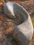 Water Carved Boulder. A uniquely shaped granite boulder from years of water flow Royalty Free Stock Image