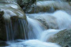 Water cascade. In boulders close up Stock Photo