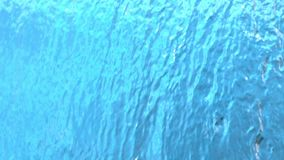 Water cascade pouring down in slow motion abstract background at 1500 fps. Tabletop stock video footage