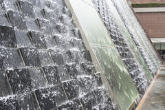 Water Cascade. Stone and glass water cascade feature royalty free stock photography