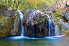 Water cascades on a mountain river Royalty Free Stock Images